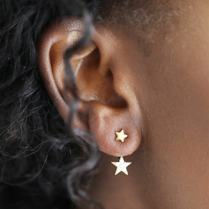 a woman modelling the double star earring