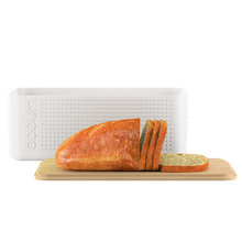 Load image into Gallery viewer, the bread box with some sliced bread sitting atop the lid