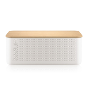 an off white bread box with the bodum logo and a uniform dot pattern embossed and a bamboo lid