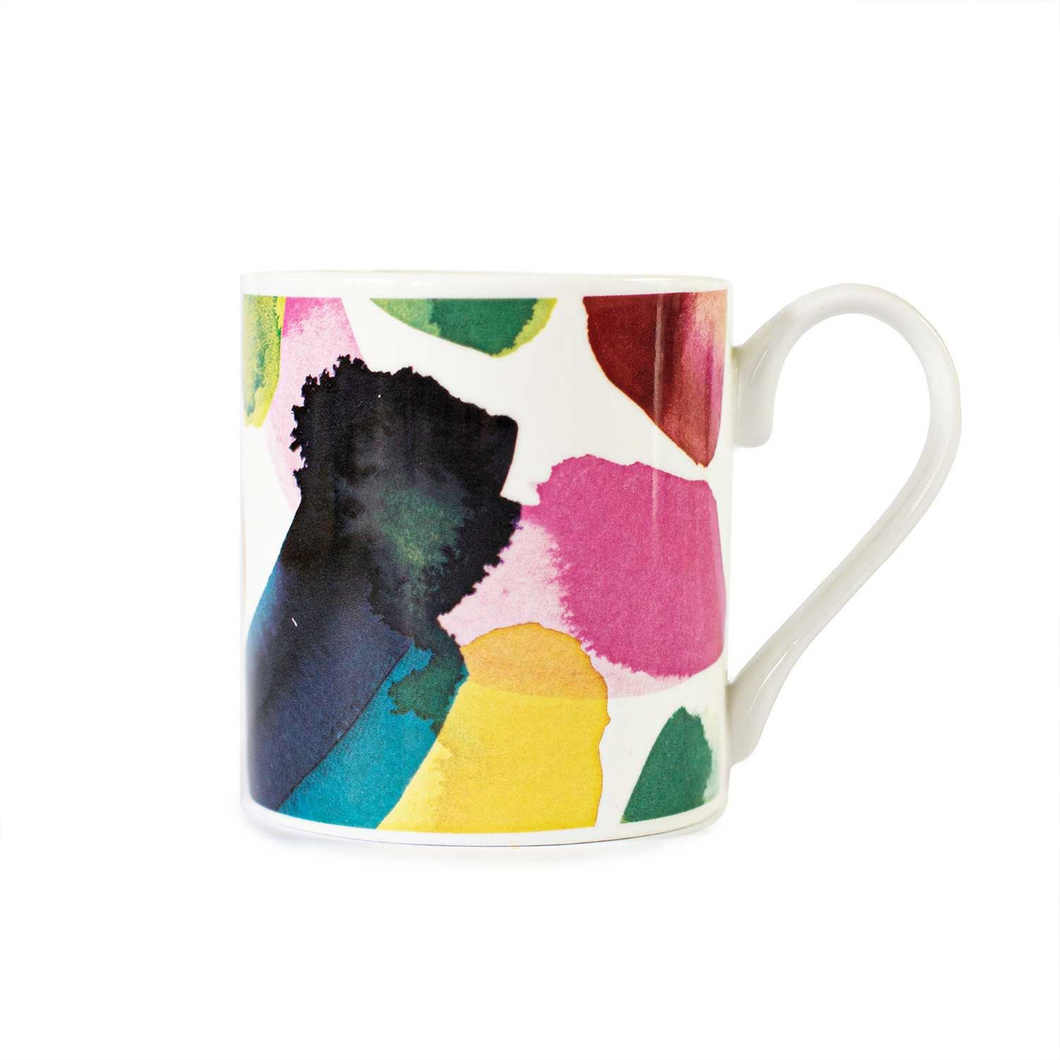 a mug with a colourful watercolour pattern