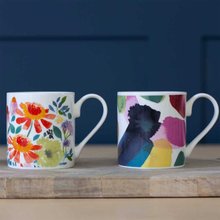 Load image into Gallery viewer, the mug on a table with a floral mug to it's left