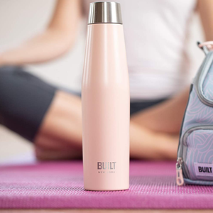 the water bottle sitting on a yoga mat