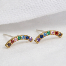 Load image into Gallery viewer, a pair of stud earrings comprising of a gold curve with rainbow coloured gems accross it