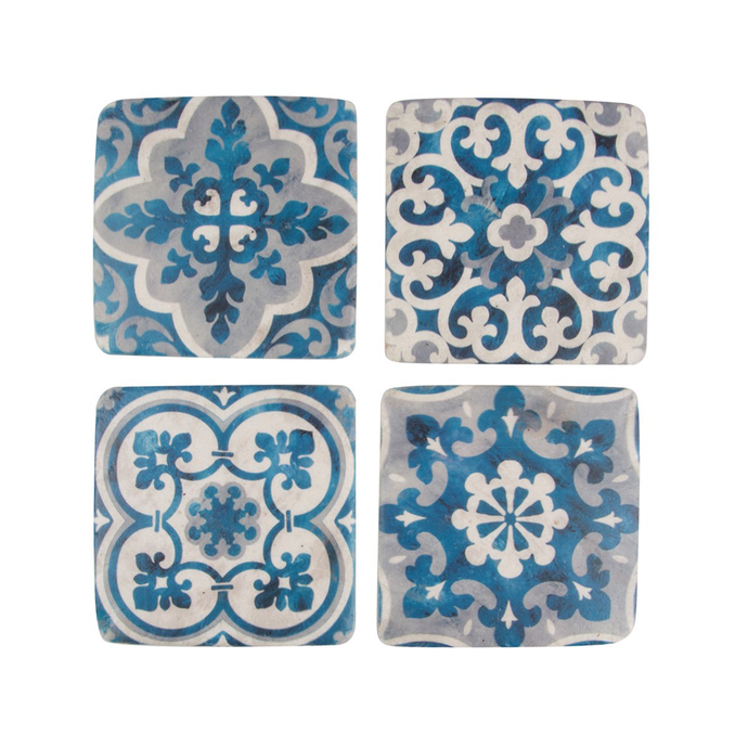 a set of four coasters with different tile inspired blue, white and grey patterns