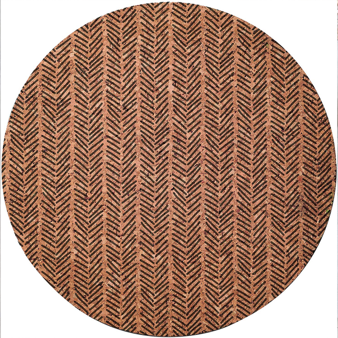 a cork placemat with a chevron pattern