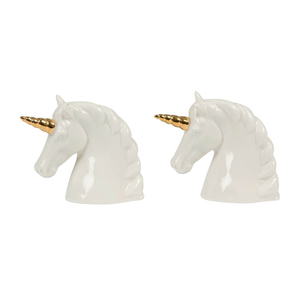 a pair of white unicorn shaped salt and pepper shakers with gold horns