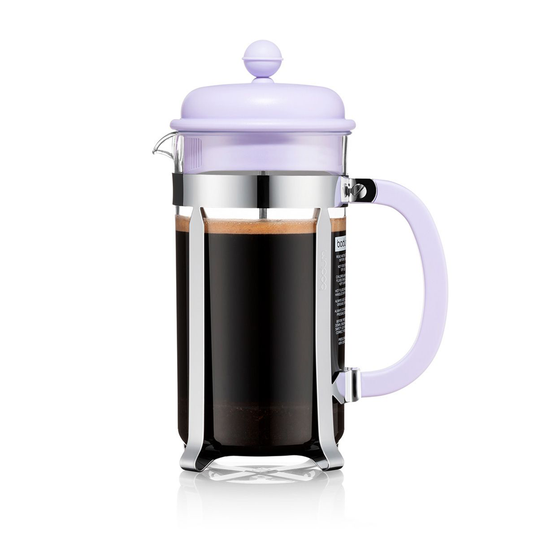 A french press with a glass tumbler and stainless steel and lilac plastic hardware