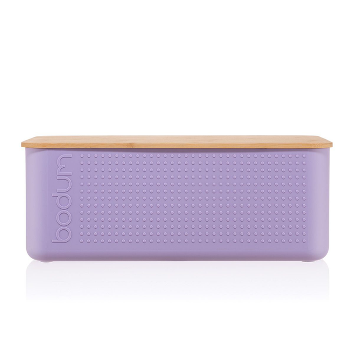 a verbena bread box with the bodum logo and a uniform dot pattern embossed and a bamboo lid
