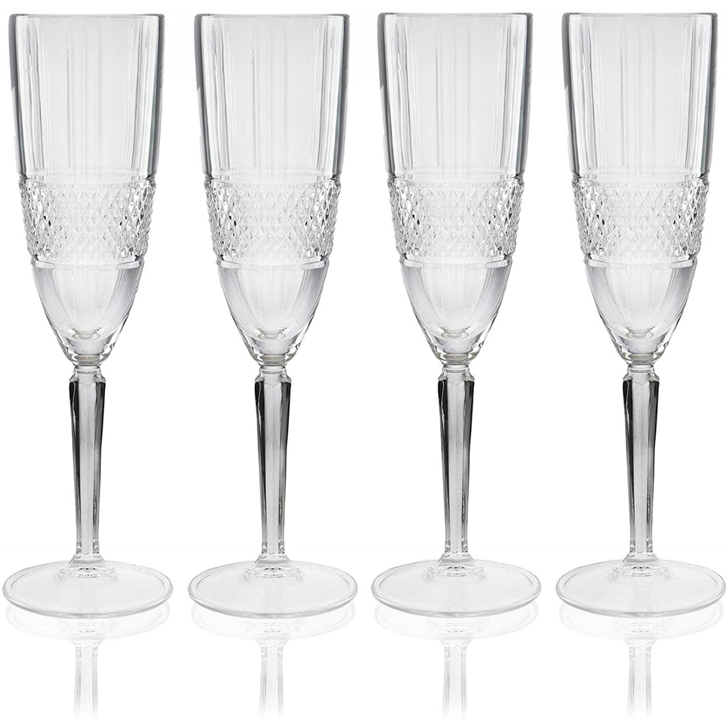 four crystaline flute glasses displayed in a row