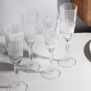 the set of four glasses shown on a table