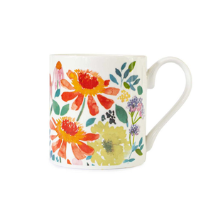 a mug with a vibrant floral pattern