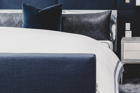 Custom bedding, pillows, and headboard for commercial interiors including hotels