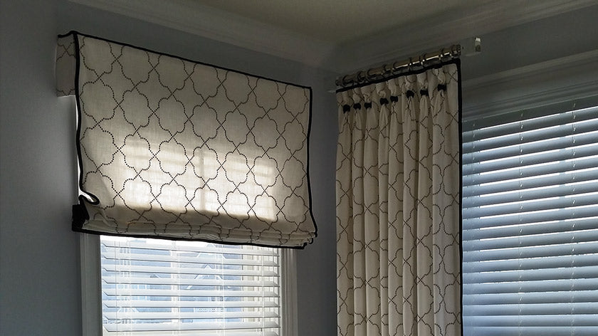 Window treatments including shades and drapes