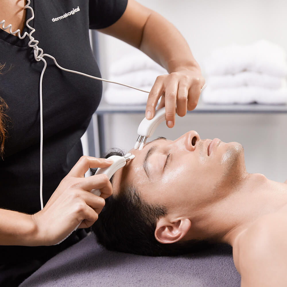 dermalogica professional performing a treatment on a customers skin
