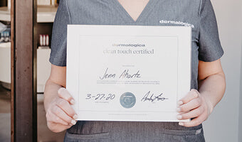 Woman holding a certificate