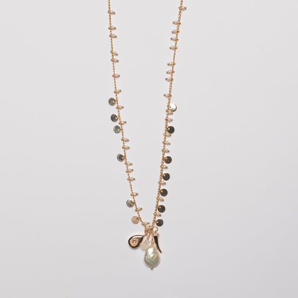 LONG PEARL NECKLACE WITH CHARMS