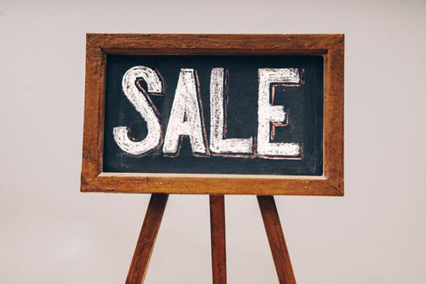 SALE sign - second hand sales can be a great way to find cheap drag costumes