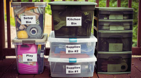 labeled storage bins for camping