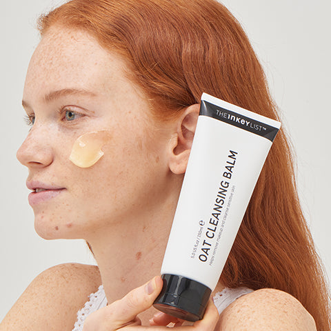 Model with Oat Cleansing Balm bottle