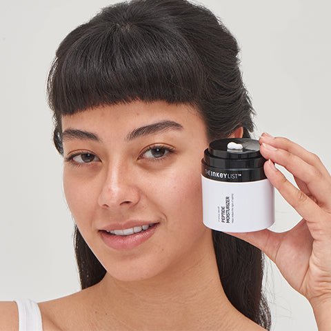 Model with Peptide Moisturizer near her face