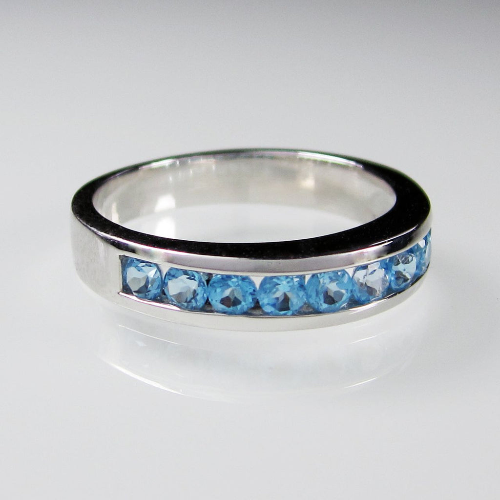 Orah London eternity ring with blue topaz