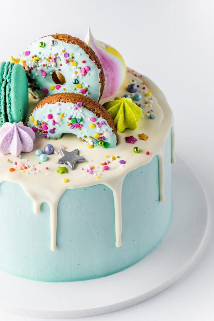 decadent cake topped with sweets and sprinkles!