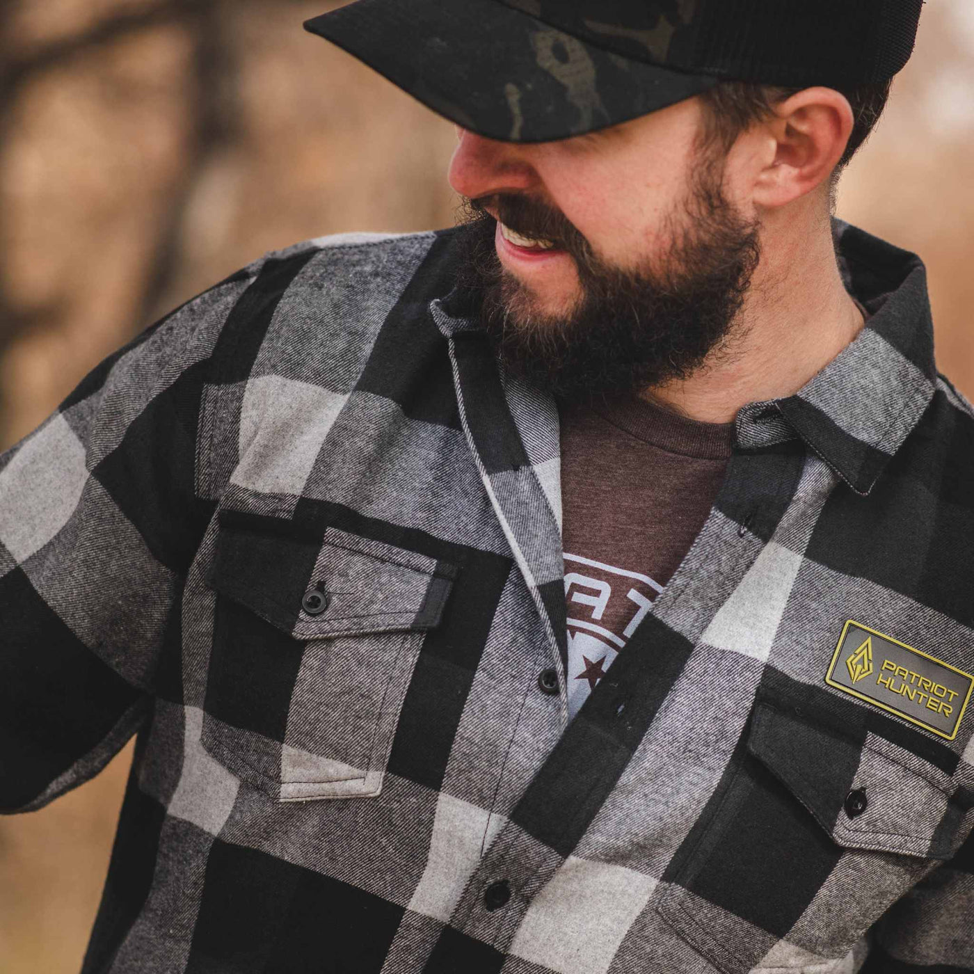 Man in grey and black flannel shirt