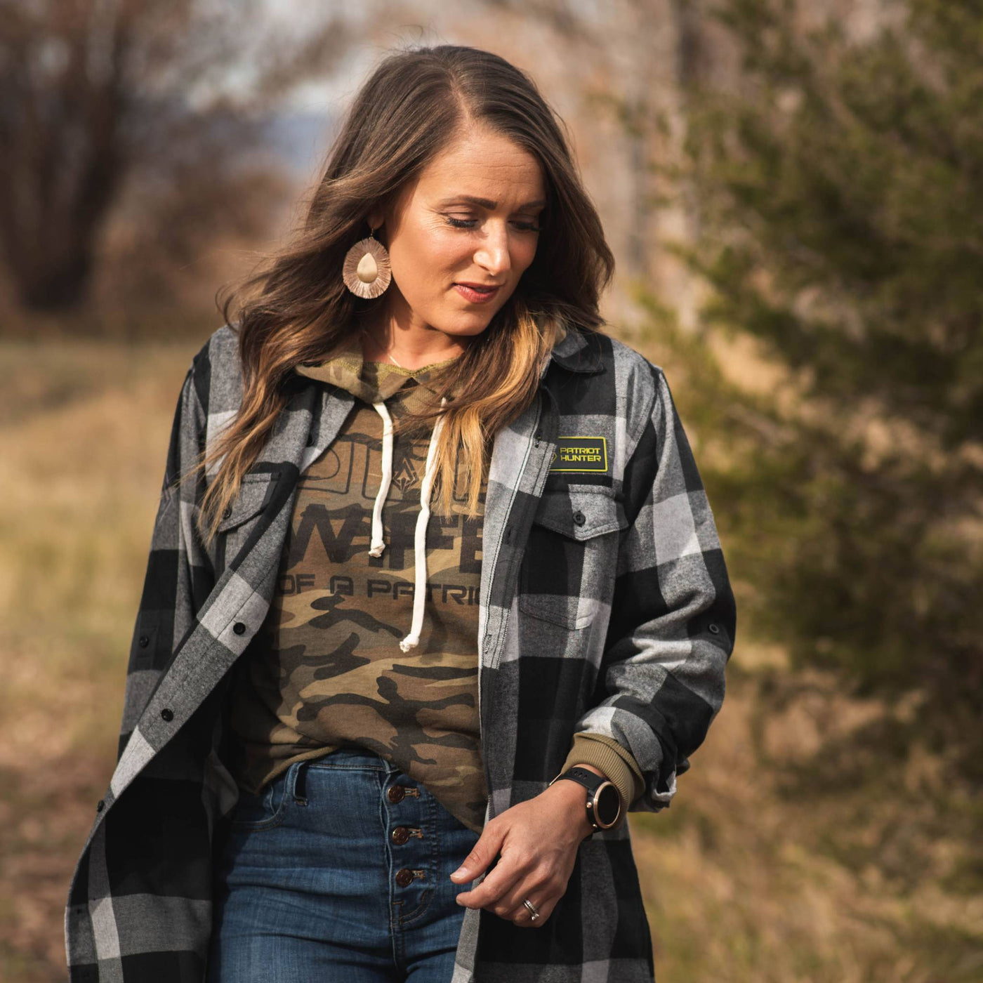 Women in plaid and camo hunting apparel