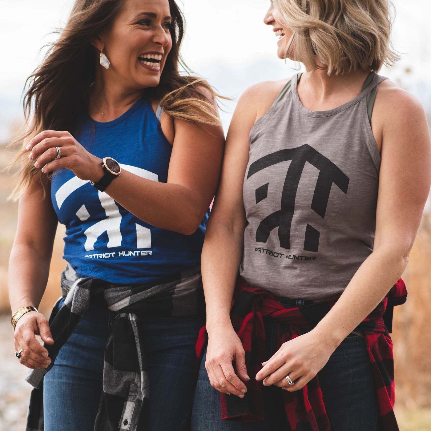 two women in hunting tank tops