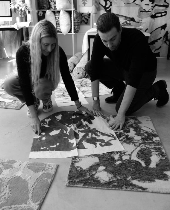 Two designers examine samples on the floor