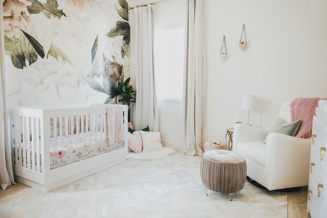 floral mural in a white nursery