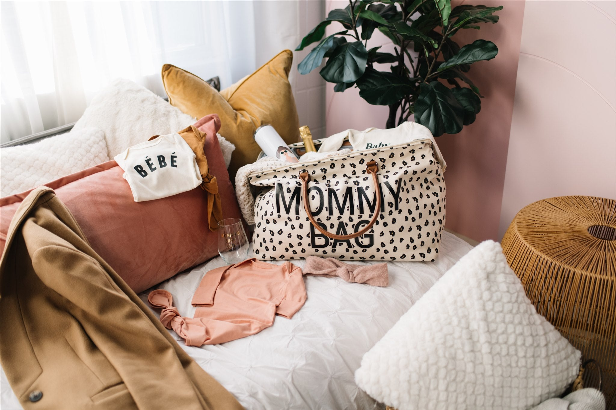 the leopard print mommy bag with onesies and knotted gowns