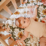 Load image into Gallery viewer, baby girl in crib with white floral crib sheet