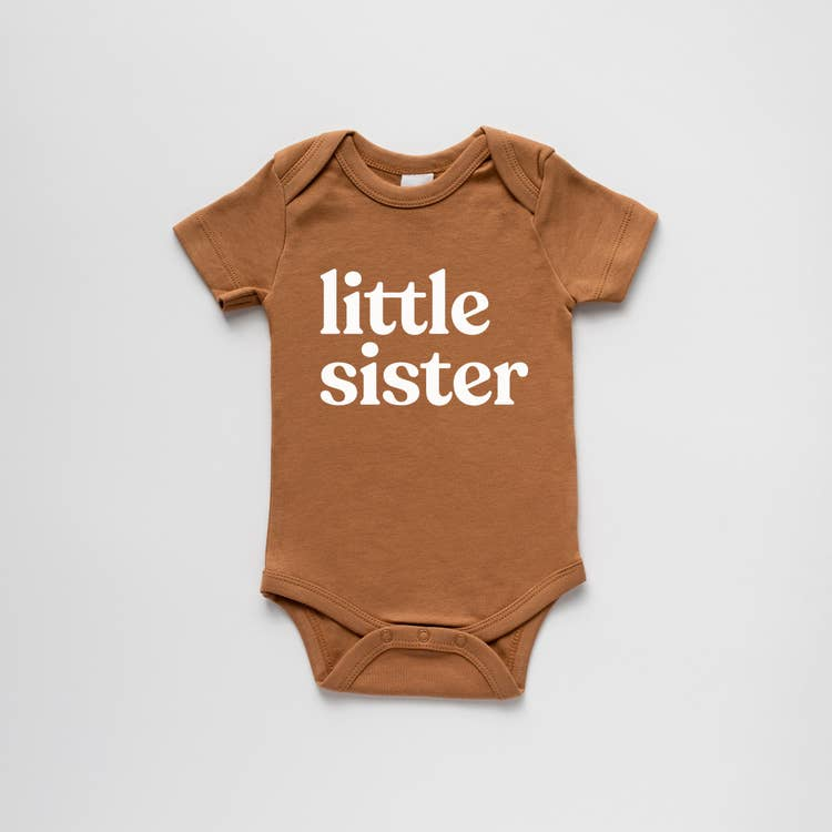 new baby gift organic cotton onesie with little sister screen print on camel coloured onesie