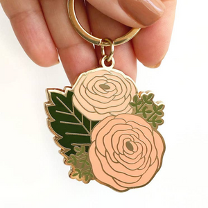 gold enamel keychain with ranunculus flowers and green leaves
