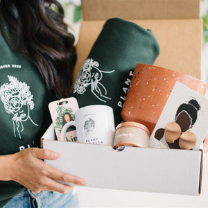 plant mom christmas gift idea with planter, sweater, mug and candle