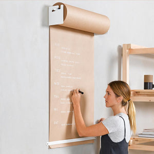 writing on kraft paper roller with white mounting hardware