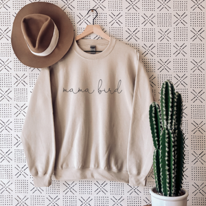 women's graphic sweatshirt with mama bird font in black on cream coloured sweater