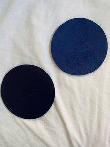 Integral leather coasters.