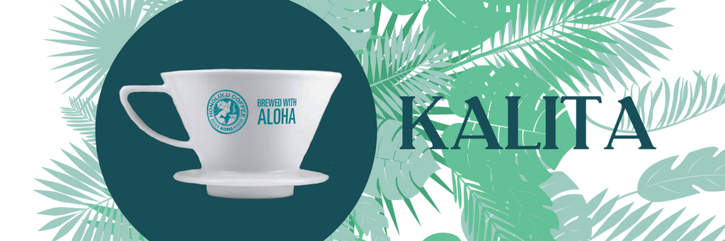 A Kalita Wave 185 brewer in front of tropical plants
