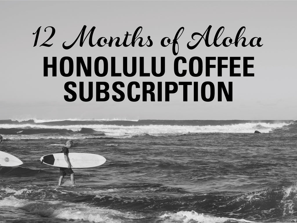 Black and white photo of ocean and surfer - 12 Months of Aloha Gift Coffee and Kona Subscriptions - Give the gift of Kona Coffee for 12 Months!