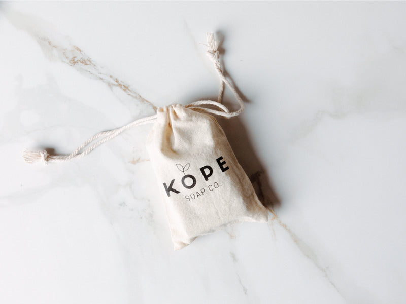 Kope soap in a branded bag on granite