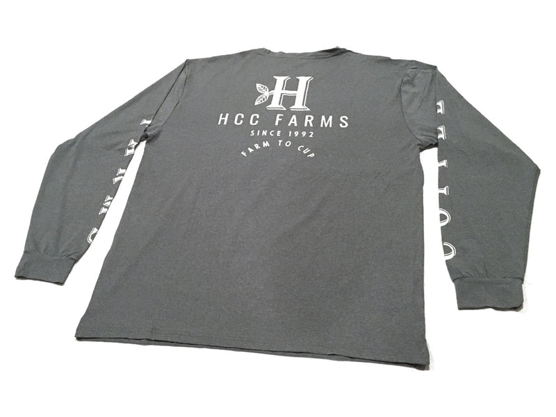 "The back of the Grey long sleeve farm shirt from Honolulu Coffee - ""Coffee Farms"" down the sleeves"