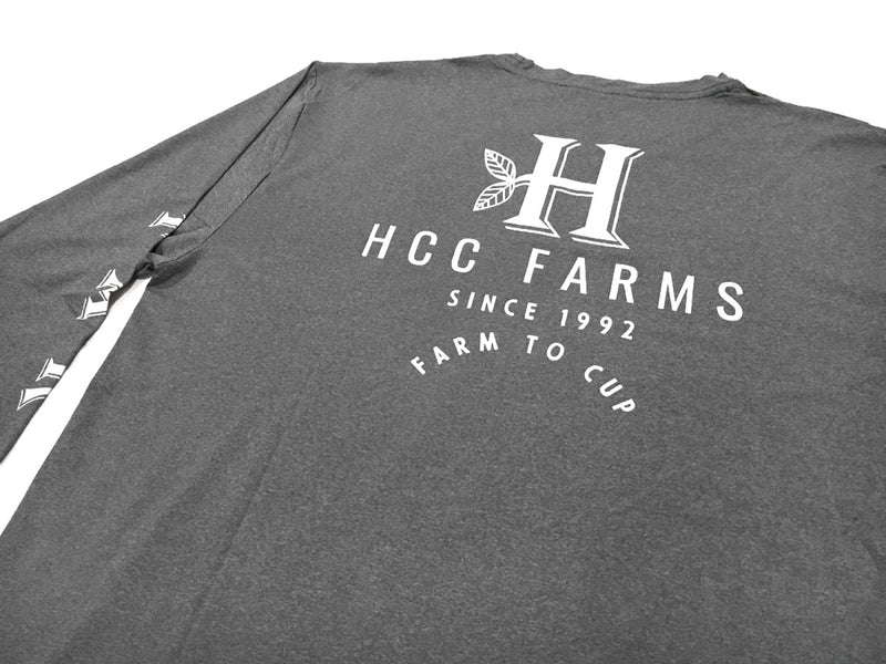 "Close up of the back of the Grey long sleeve farm shirt from Honolulu Coffee - ""Coffee Farms"" down the sleeves"