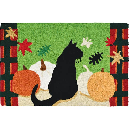 Pumpkin patch cat accent rug.