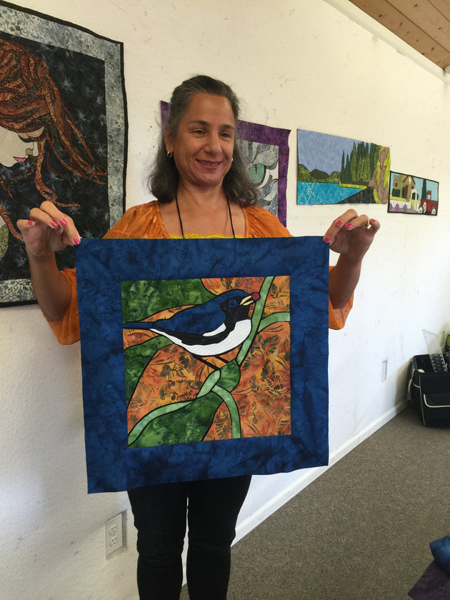 Grace with her final Blue Bird Quilt Panel
