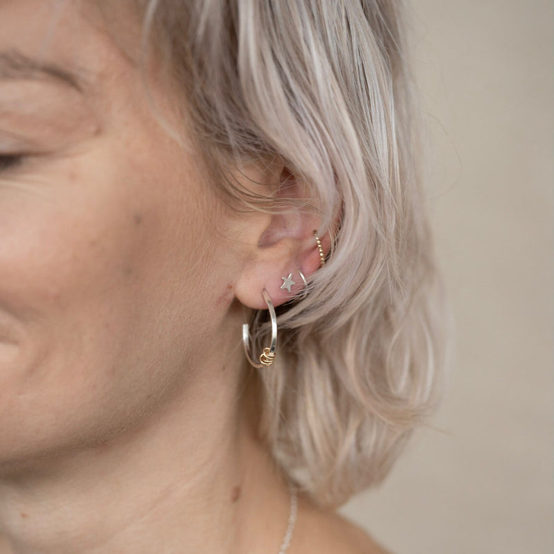 The Tizzy Twist Earrings - sterling silver cuddle hoop earrings - twist hoop earrings - single piercing stud hoops