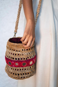 Round embroidered bag