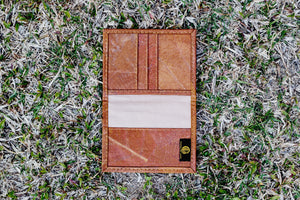 Vegan passport overs made of teak leaf available in black, red, purple, orange and green. Cruelty-free passport cover open