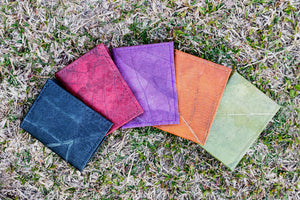 Vegan passport covers made from teak leaf available in 5 different colours Black, Read, Purple. Orange, Green